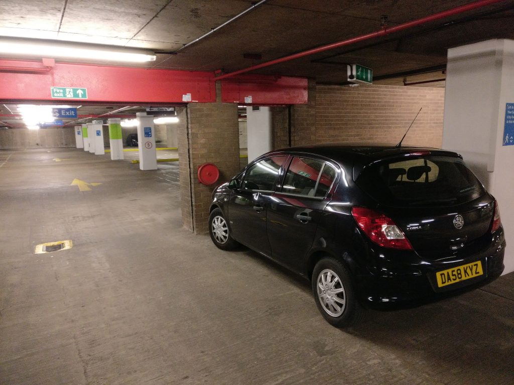 Black Vauxhall Corsa in way of Fire Exit in Secure Car Park Liverpool DA58 KYZ