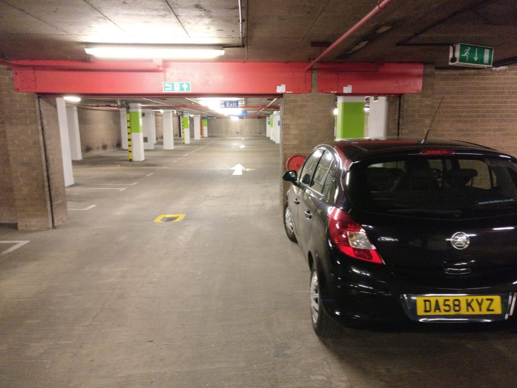 Alternative shot of Black Vauxhall Corsa DA58 KYZ in way of Fire Exit in Secure Car Park Liverpool